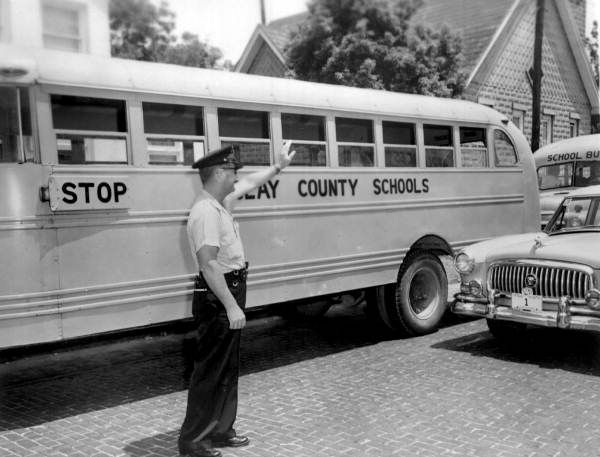 Clay County school bus and patrolman - Green Cove Springs, Florida