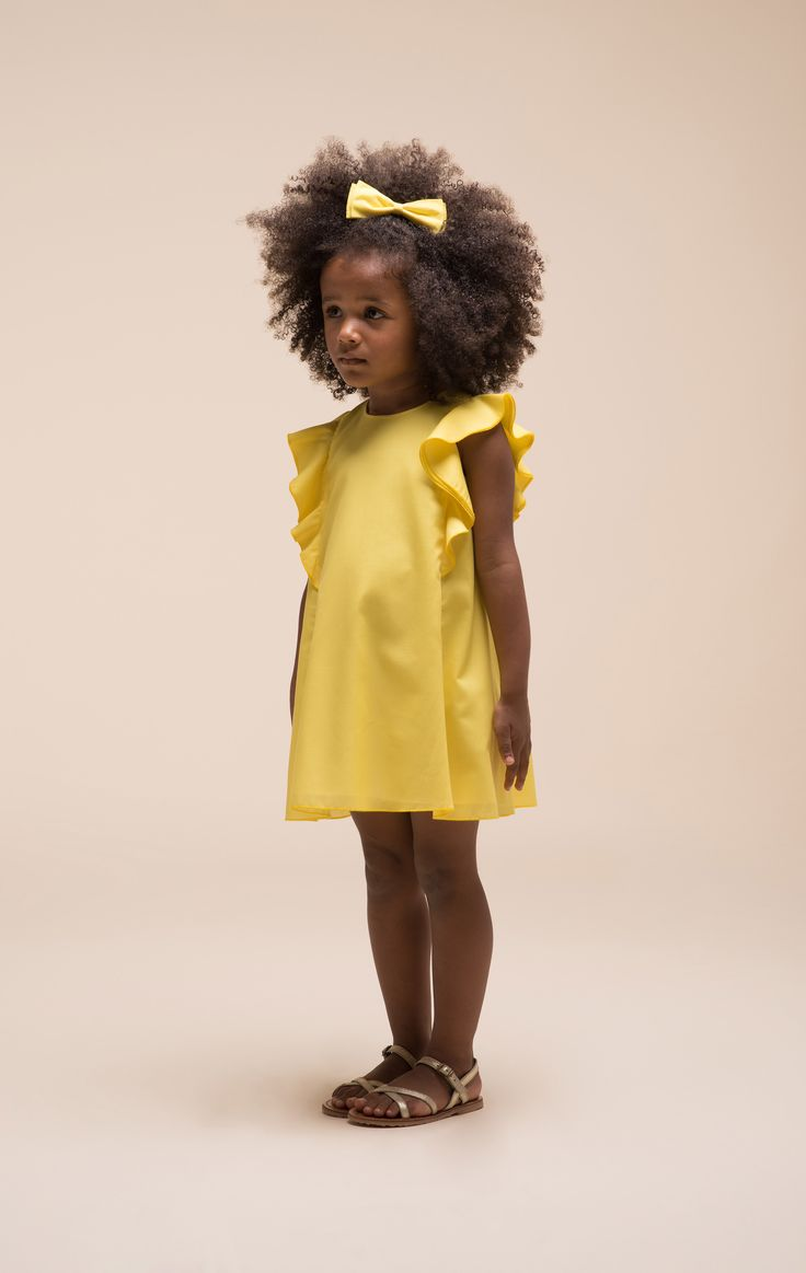 Vivid yellow ruffled sleeve dress at Hucklebones English modern classic kidswear for spring 2016