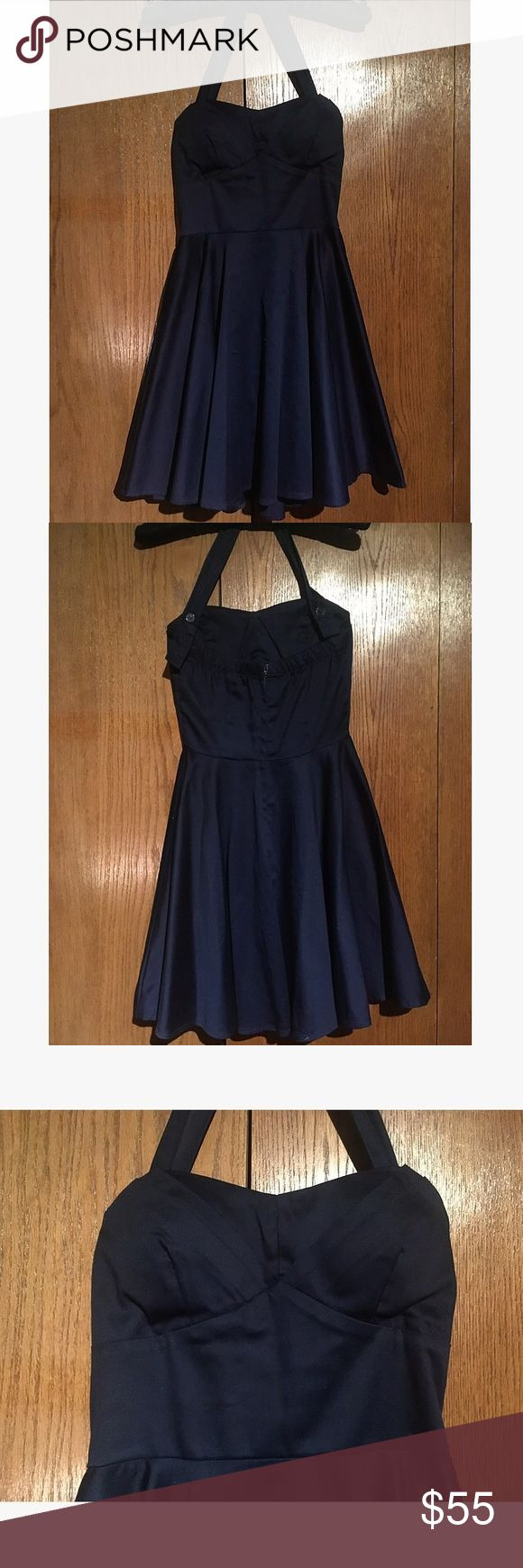 Traveling Cupcake Halter Dress in Navy Size S Navy blue A-line halter dress from Modcloth, size small, worn once, great condition!            •Elasticized back. Adjustable halter strap.  •Lined bust. Back zipper closure. Padded bust cups. •Length from bust to hem 26in. Length of skirt 17.5in. Length of waist laying flat 11.5in Modcloth Dresses Mini