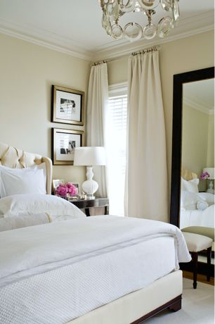 peaceful cozy space, expanded space with floor length mirror and floor to ceiling drapes.