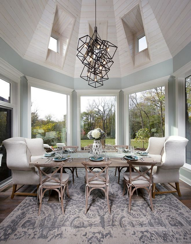 Elegant Dining Nook Surrounded By Windows And A Dramatic Shiplap Ceiling.  Paint Color Is Sherwin Williams Comfort Grey SW Barrington Homes Inc.