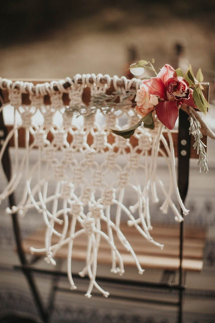 Macrame seatbacks from this bohemian glamping wedding inspiration | Image by Lieben Photography