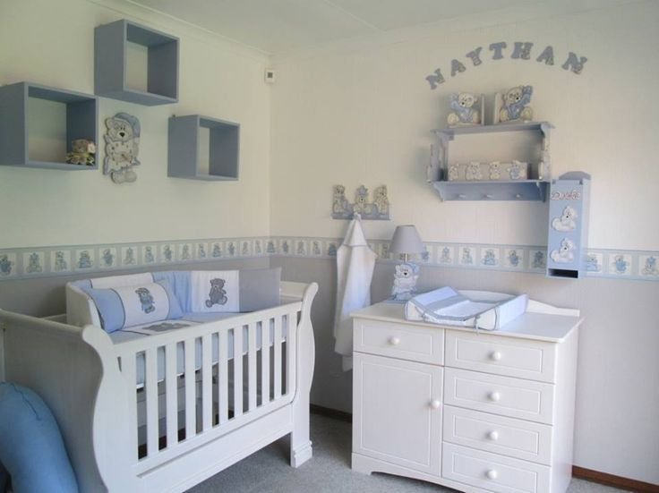 Grey tatty teddy nursery decor - walls painted neutral with white and grey and custom printed scruffy bear wall border, the room is complemented with white wash furniture for a classic look. Contact us on Facebook - www.facebook.com/borderboutique.co.za