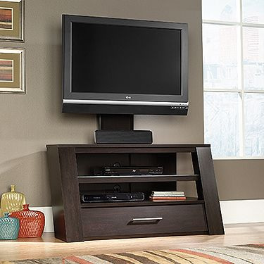 """Mount/stand accommodates up to a 42"""" TV weighing 95 lbs. or less. TV mount with built-in cord management features height and swivel adjustment. Shelves hold audio/video equipment. Middle shelf features safety-tempered glass. Drawer features metal runners and safety stops. Quick and easy assembly with patented slide-on moldings. Jamocha Wood finish."""