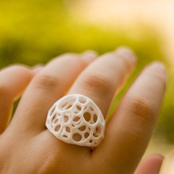 This final design is built up layer by layer in durable nylon plastic using Selective Laser Sintering, a kind of 3D printing. These forms would be impossible to create by traditional manufacturing methods. The process imparts the pieces with a coral-like texture, while the slight flexibility of nylon and airy design make it fun to wear.