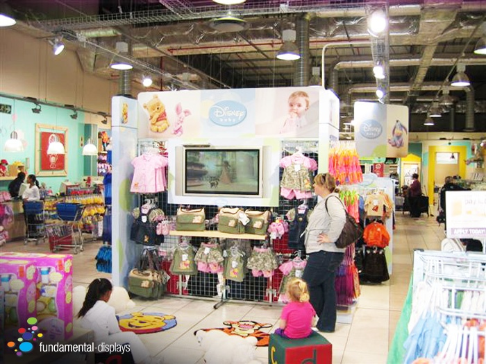In July 2009 Fundamental Displays designed and project managed the implementation of a Disney branded store inside The Baby Company store at the Cape Gate Mall, Cape Town, South Africa. Our design and solution included branding the Disney floor space primarily with inexpensive cladding onto the existing floor equipment mainly using X-Board which is a 100% recycled product.  One of the attractive features included is a TV playing Disney DVDs that is installed onto the floor wall stand amongst…