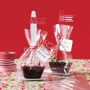 Place each spoon in a flat cellophane bag (we also used a cardboard insert for stability) and tie with kitchen twine or ribbon. To serve, stir chocolate spoon into 8 ounceshot milk.