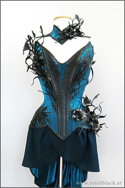 Opulently Gothic: Royal Black Royal Black is another continual crowd-pleaser, with their beautiful laser-cut designs, distinctive point of view, and unique detailing. Collection pieces may feature bright colors, metallics, and even pastels, but the result aesthetic is always touched with the essence of a fairy tale evil queen, in the most awesome way possible.