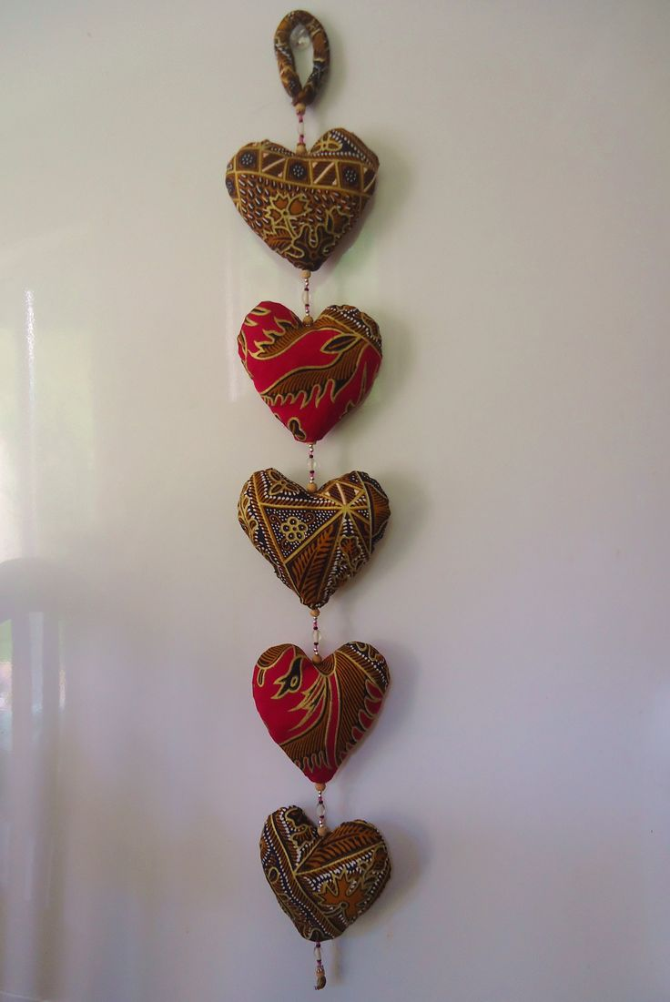 Bought some batik material in Bali recently to make presents for family and friends. This is a simple heart pattern with beads. Next, some elephants!