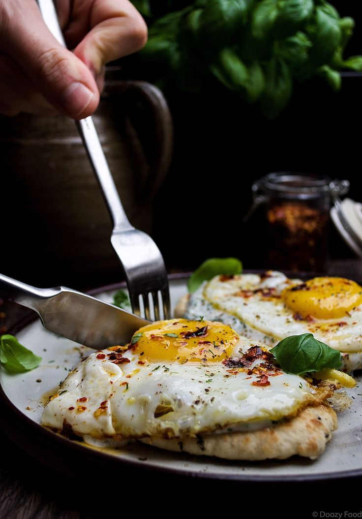 Naan Bread topped with Fried Eggs, Herbed Yogurt and Chili Butter