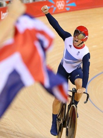 Chris Hoy of Great Britain celebrates after setting a new world record and winning gold in the men's Team Sprint Track Cycling final