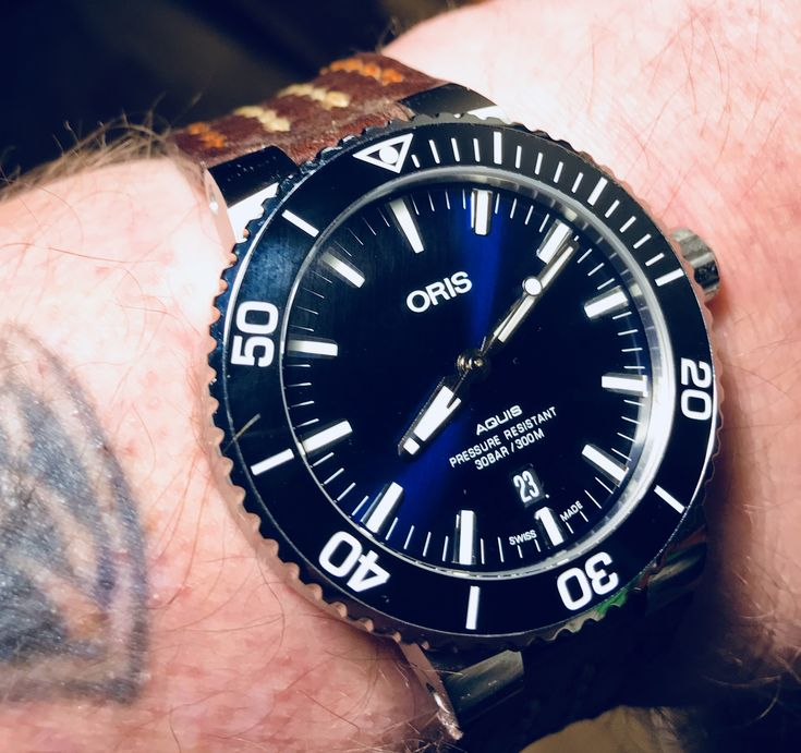 My Oris Aquis Date with a costume made leather strap from Russia. Great work and looking good as well.