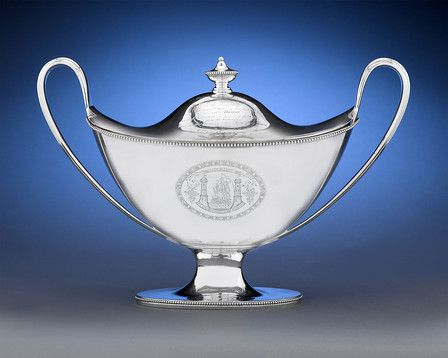 """This presentation silver soup tureen is one of two large items Hester Bateman ever made. Given to the Sheriff of Cork for his bravery during the Irish Rebellion   Elegant Greco-Roman form befitting Bateman's gift for form and proportion.  A true rarity of Hester Bateman silver   Inscribed; Hallmarked London, 1787   Measurements: 7 3/4"""" wide x 8 3/8"""" deep x 11 1/2"""" high   Exhibitor: MS Rau Antiques"""