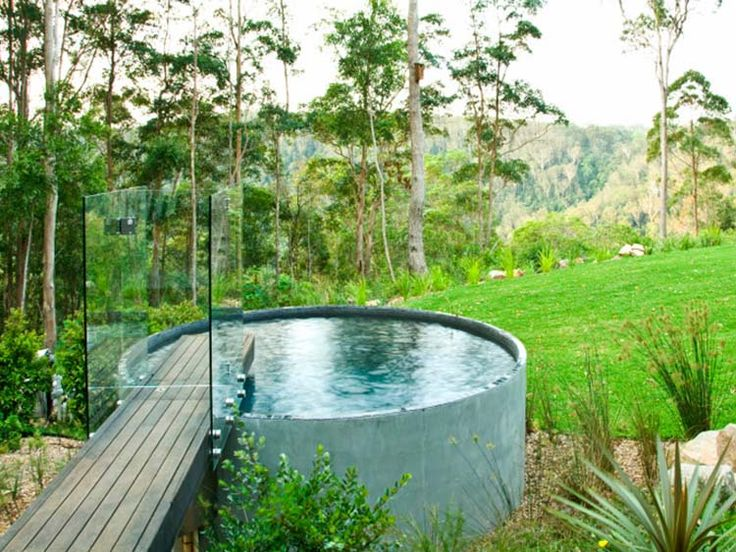 A pre-cast concrete rainwater tank was converted into a plunge pool and accessed via a bridge! You would need a Bionizer filtration system (salt and chlorine-free pool ionisation system) and an interior pool finish. Sit it on a concrete slab with 75 mm of gravel underneath (via Renovate Forum)