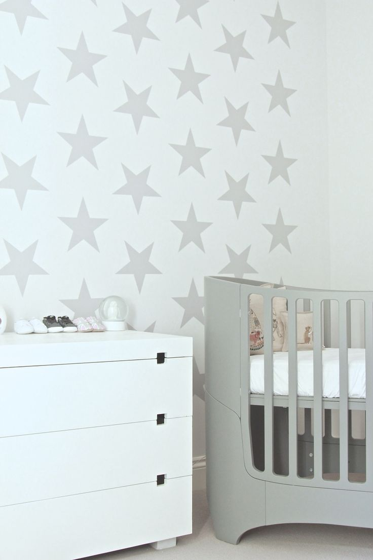 Leander Cot, Coral & Tusk pillows, Starry wall decor and West Elm dresser.   Nursery Design by Blank Slate Studio. Email: hello@blankslatestudio.com
