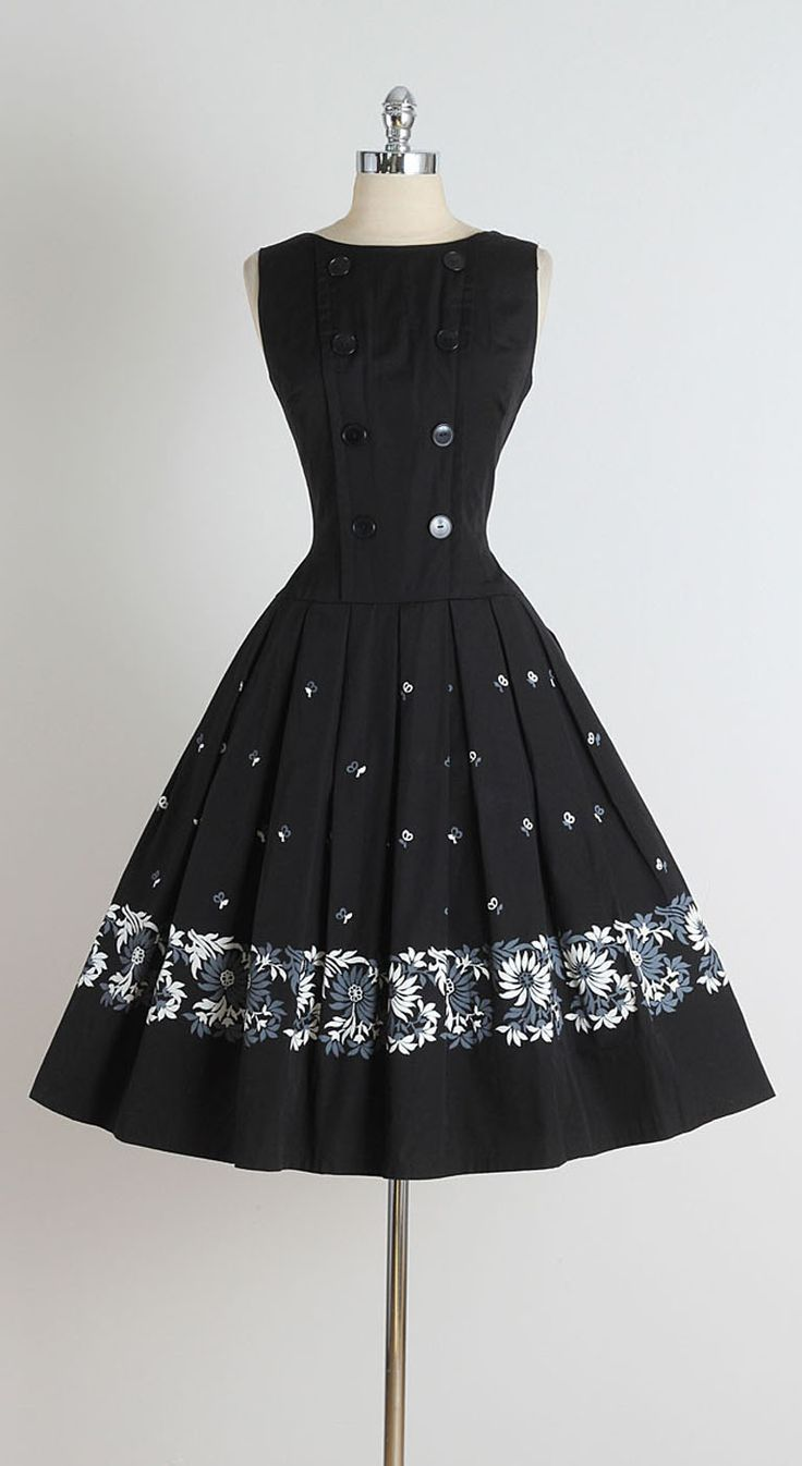 1950s Black Brushed Cotton Daisy Print Dress | From a collection of rare vintage day dresses at https://www.1stdibs.com/fashion/clothing/day-dresses/