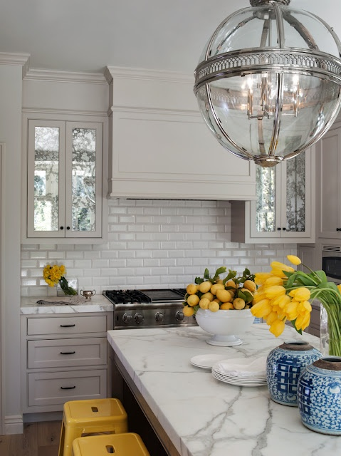 Crown detailing on uppers if we do a 10' ceiling: Idea, Pendants, Lights Fixtures, Countertops, Marbles, White Subway Tile, Yellow Accent, White Kitchens, Cabinets Doors