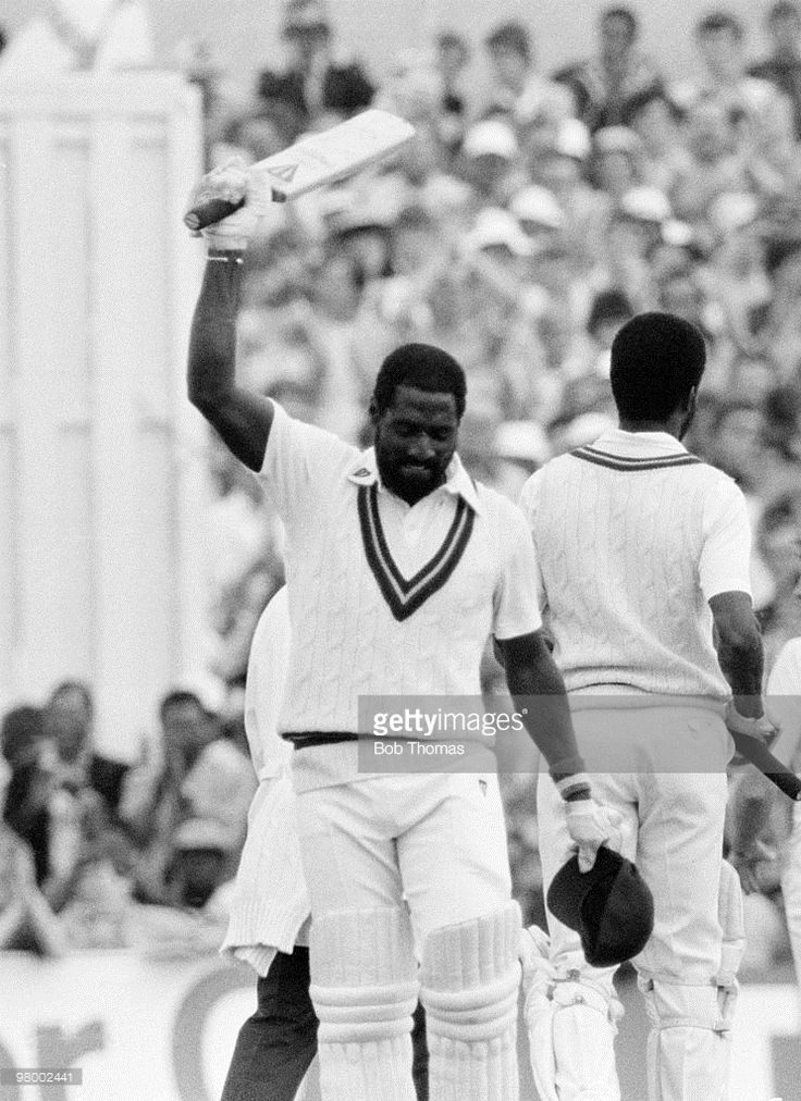 West Indies batsman Viv Richards acknowledges the crowd after reaching 150 during his innings of 189 not out in the Texaco One Day International match against England at Old Trafford in Manchester, 31st May 1984. Viv Richards and Michael Holding (right) added 106 runs in a last wicket partnership, with Richards scoring 93 of them in 14 overs. West Indies won the match by 104 runs.