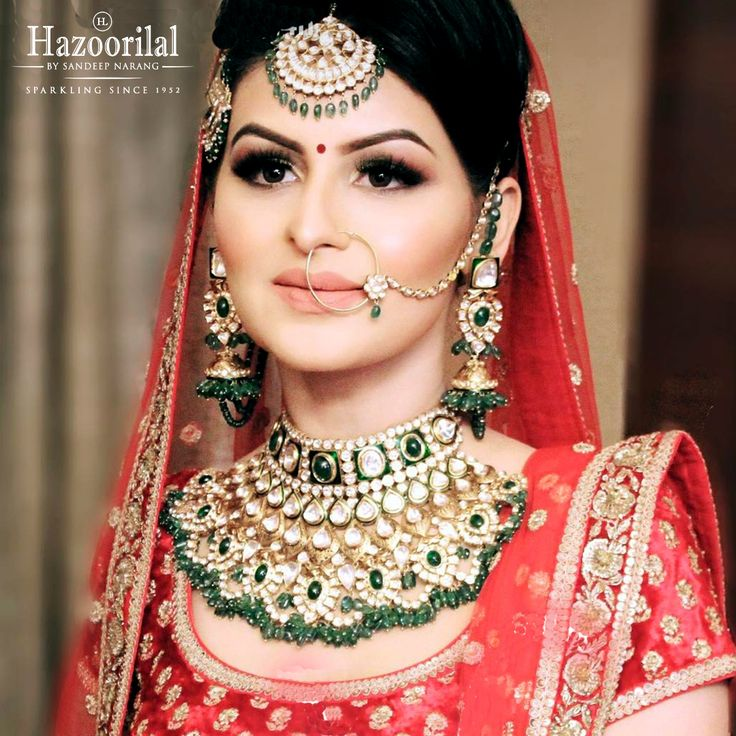 The quintessential Hazoorilal Bride in Polki and Emeralds choker makes a luxe wedding statement.  #HazoorilalBySandeepNarang #HazoorilalBrides #Polki #Emeralds #Choker #Passa #MaangTikka #ItcMaurya #DlfEmporio #GK-1 #Since1952 #HazoorilalJewellers #Hazoorilal