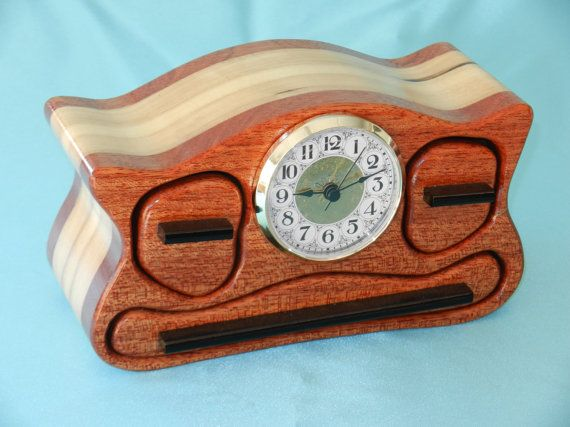 My band saw box clock is made of mahogany face and back. The body of box is made from either poplar. The pulls are from ebony. The box represented in