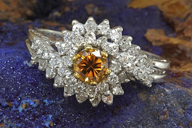 18k white gold ring with .63ct total weight of single cut diamonds, SI-1 to SI-2 clarity and G-H in color, with a .38ct fancy brownish orange center diamond of SI-1 clarity.
