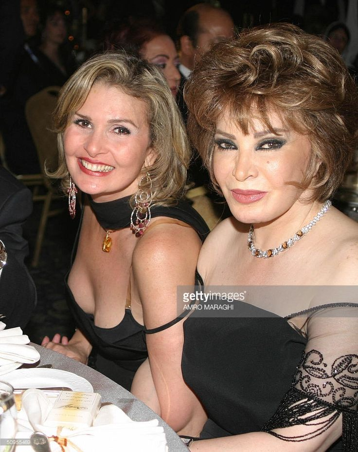 Egyptian film stars Yusra (L) and Safiya al-Omari attend the wedding party of Ali Salameh and Jordanian Dina Ghalayini at a Cairo five-star hotel late 12 June 2004. Salameh is the son of Lebanon's former Miss Universe Georgina Rizk and the late Palestine Liberation Organization (PLO) intelligence service chief Ali Hassan Salameh, known by his nom de guerre Abu Hassan, who was assassinated in Beirut in 1979. AFP PHOTO/Amro MARAGHI