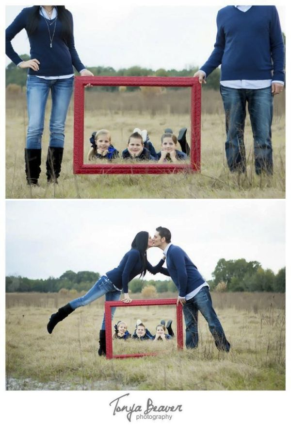 Kids laying in a field while the parents hold a red picture frame kids covering their eyes while their parents kiss so cute Live Oak family photos - Live Oak Photographer - Jacksonville Photographer - Tonya Beaver Photography022 by graciela