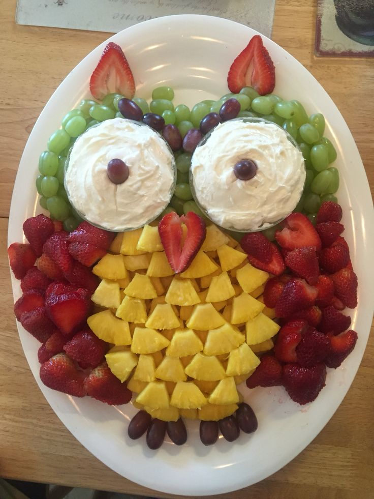 """I couldn't find a fruit tray for an owl without the pineapple shell. Fruit used is red and white grapes, strawberries, and pineapple."""