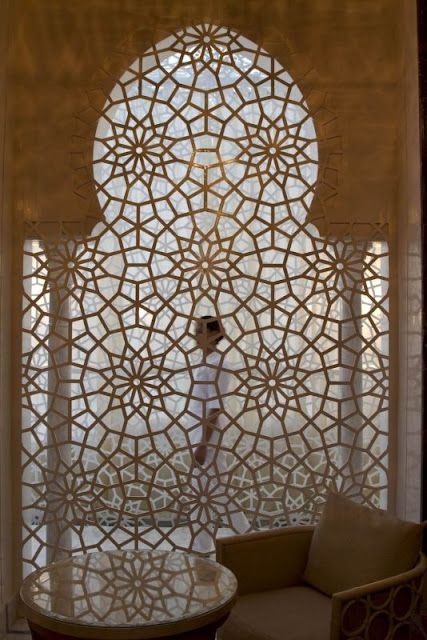 I'm obsessed with moroccan screens!  Maybe this would be an idea for the arch at the stove?  ~  Window Inspiration
