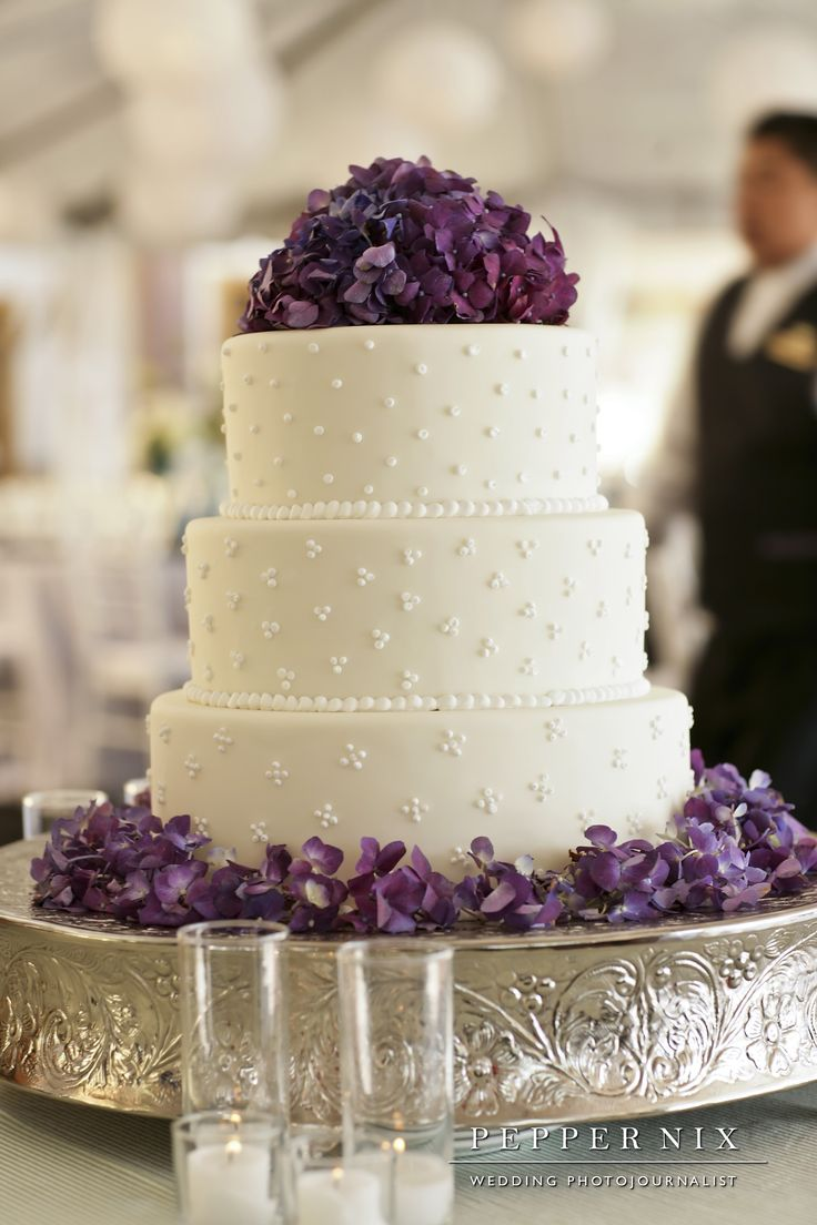 Purple flowers on three-layer cake