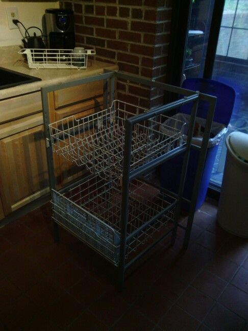 Dish drying rack, upcycled using dishwasher racks and part of a frame from a patio bar. The top rack slides out to make it easier to get to the bottom for larger items, and I'll be adding casters so I can move it around my kitchen.