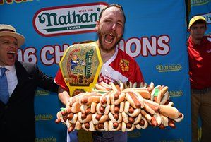Mens winner Joey Chestnut ate 70 hotdogs in the allotted 10 minutes