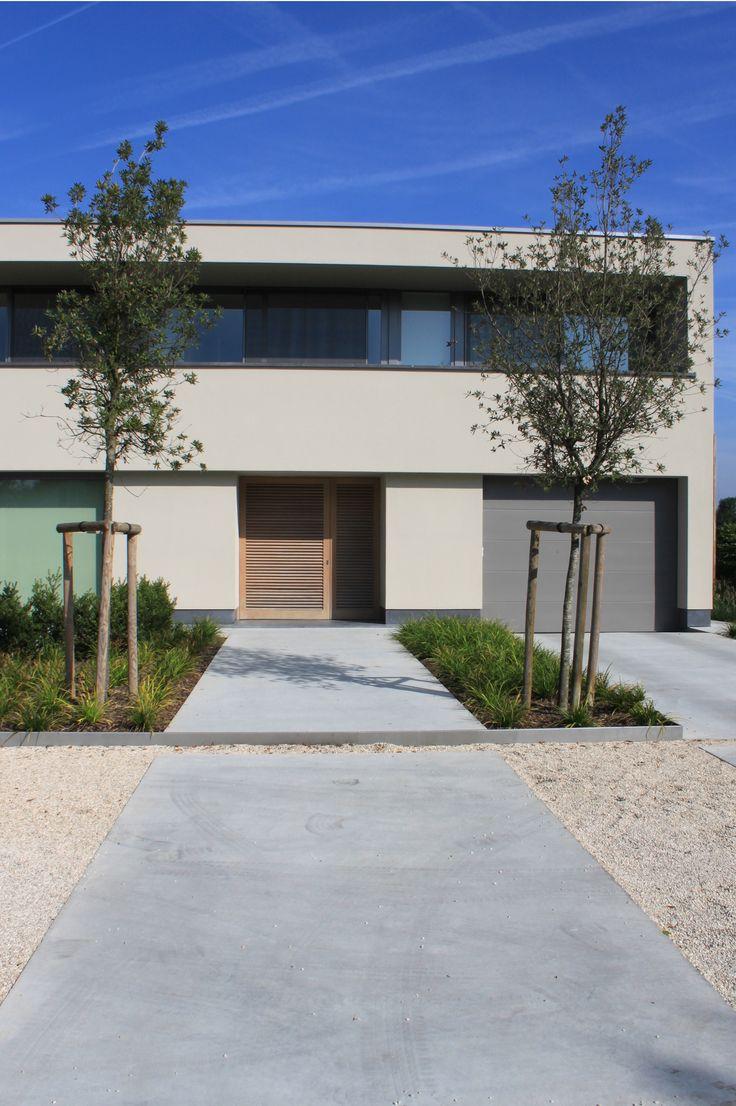 studio k - tuin wolvertem 2011 (garden, tuin, voortuin, concrete, gepolierde beton, quercus ilex, siergras, castle grind, boord gelakt staal)
