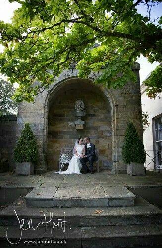 Bride and Groom wedding shot. Archway. Classic wedding photography.