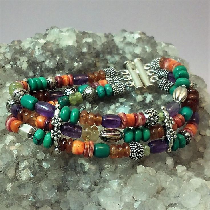 Three strand bracelet of mixed stones and sterlilng silver by KateNolanJewelry on Etsy https://www.etsy.com/listing/534437743/three-strand-bracelet-of-mixed-stones