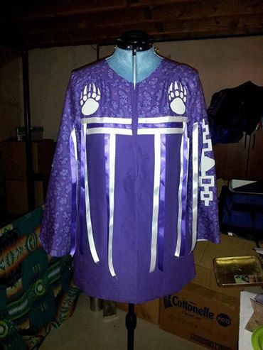 Cotton and satin ribbon, Native American Ribbon shirt that has the Hiawatha Wampum belt along the sleeves and bear paws on the chest. Colors can be changed if you like. Custom order takes about a week from order to shipping. The paws can also be changed if desired.