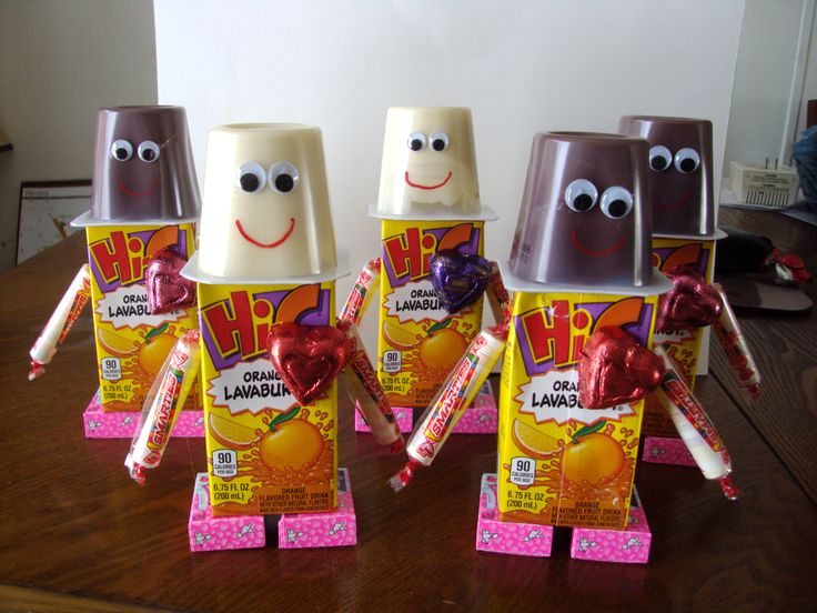 Valentines for my Daycare kiddos! Fun and easy to make robots. Juice box body, pudding head with google eyes, smartie arms, nerds feet and a chocolate heart. They love them and they are cute to display.