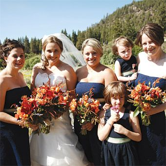Robin and Gordon in Glenbrook, NV. The bridesmaids wore navy-blue J. Crew dresses; their sashes were made of ribbon from The Ribbonerie, in San Francisco. The flower girls%u2014Annika, 6, and Linnea, 4, both nieces of the groom%u2014also wore J. Crew dresses.