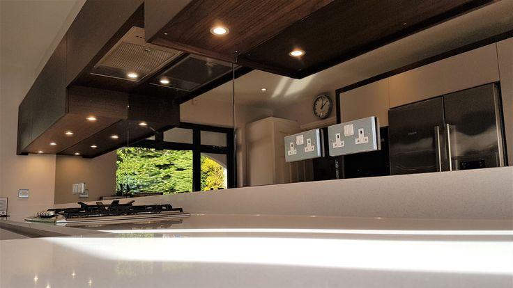 Bronze mirror kitchen splashback.