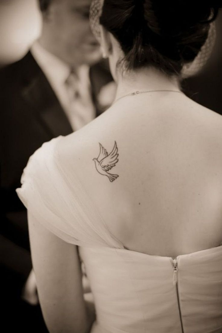 Tattoo designs on the back - 46 Impressive And Peaceful Dove Tattoo Designs