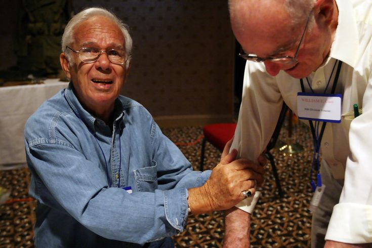 """Ernest Kan (L), a Holocaust survivor, grabs Bill Gast's arm to thank him at the 30th Infantry Division Veteran's Division of WWII reunion March 28, 2008 in Fayetteville, North Carolina. Gast was in the 743 Tank Battalion which freed the prisoners from the """"Bergen-Belson Death Trains."""" Gast said: """"No one will ever truly understand what those folks went through. I feel privileged to be a part of this."""" The annual reunion March 28, 2008 was special this year, as several Holocaust Surviviors who…"""