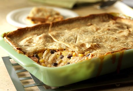 This crowd-pleasing, kicked-up casserole couldn't be easier...it uses canned chicken, soup, corn and beans and is topped with a refrigerated pie crust.  It's simply delish!