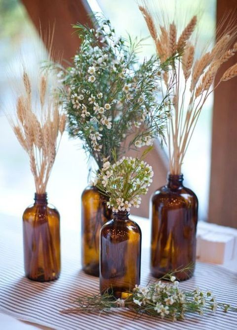 I love the amber bottles and the wheat and wild-looking flowers. (Maybe amber is too dark for the space? Wouldn't work outside would they?)