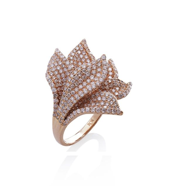 Rose gold encrusted with diamonds, pretty, delicate and quite spectacular!