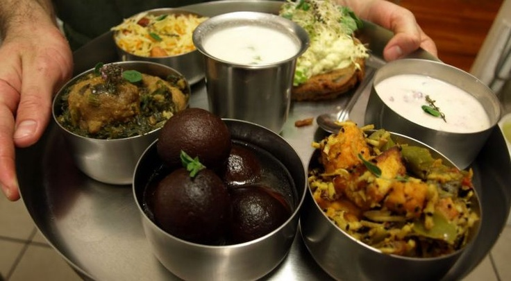 Not a restaurant, but you can get free or at cost vegan and vegetarian food at any Hare Krishna Temple in any city worldwide