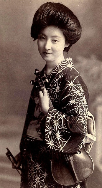 Geisha with violin , ca 1905