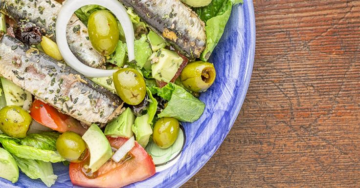 Fill up on real food with this traditional Greek salad topped with Wild Selections® Lightly Smoked Sardine Fillets.