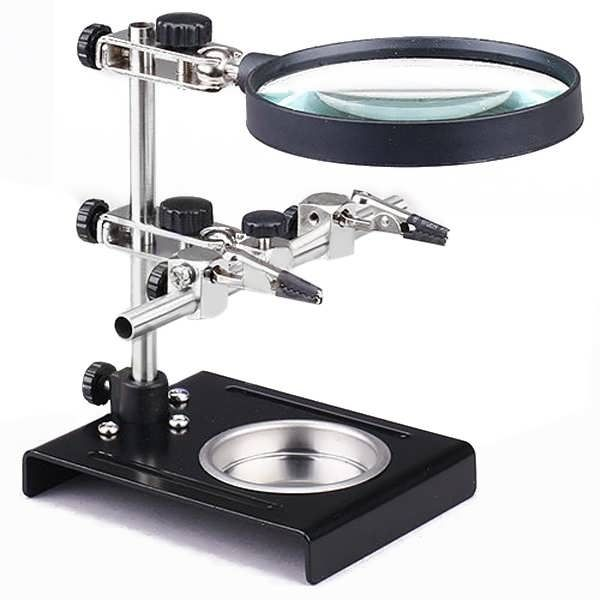 Universal Soldering Holder Stand For Welding With Magnifier  Description: Item:Solder Holder  Magnification: 3X Lens diameter: about 9cm Max width of Clamping frame: 13.5cm Max height of stand: 14.5cm Material: cast iron for base, metal pipe for support Usage:For Welding RC Model...