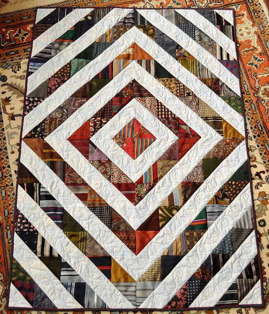"Rae's Dad's Tie Quilt by thousandpinesmargy: ""This is a lap size quilt I made for a friend of my daughter, whose Dad had recently passed away. He had been a very nice dresser, wearing a tie for almost any occasion. This quilt uses about 90 of his ties, only one piece from almost all of them."""