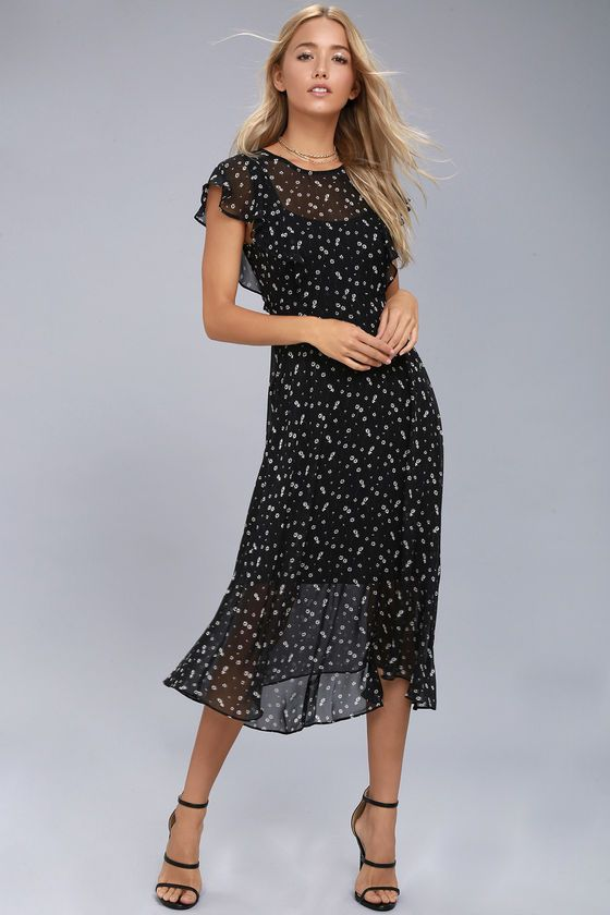 Frolicking in fields of wildflowers is what the Lost + Wander Leona Black Floral Print Midi Dress was made for! Ditsy white and green floral print decorates sheer woven poly as it shapes a high, bateau neckline, fluttering short sleeves, and a midi skirt with a slight high-low hem. Button up back and hidden zipper.